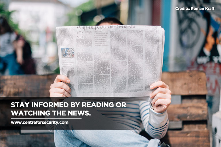 Stay informed by reading or watching the news.