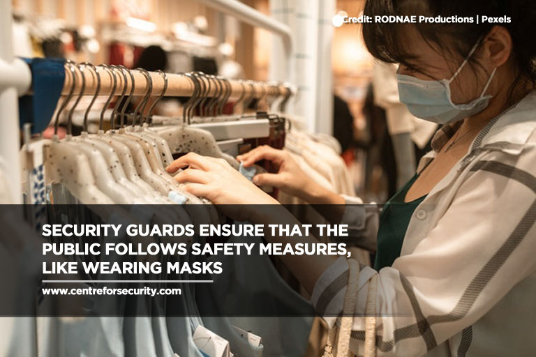 Security guards ensure that the public follows safety measures, like wearing masks